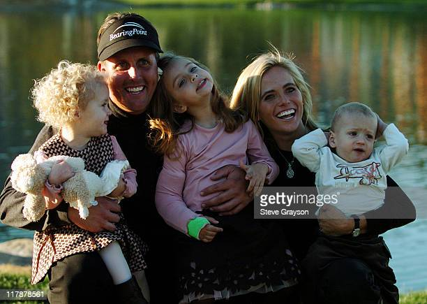 Phil Mickleson wife Amy and their children pose on the 18th green after the final round of the 45th Annual Bob Hope Chrysler Classic at PGA West...
