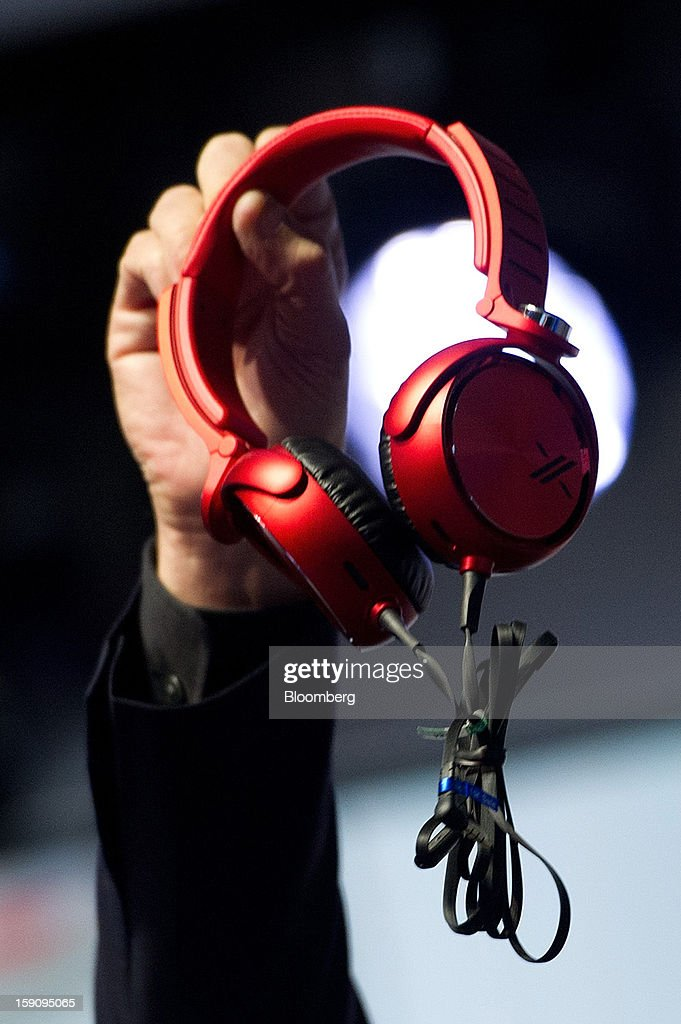 Phil Molyneux, president and chief operating officer of Sony Electronics Inc., holds up newly designed headphones as he speaks during a news conference at the 2013 Consumer Electronic Show in Las Vegas, Nevada, U.S., on Monday, Jan. 7, 2013. The 2013 CES trade show, which runs until Jan. 11, is the world's largest annual innovation event that offers an array of entrepreneur focused exhibits, events and conference sessions for technology entrepreneurs. Photographer: David Paul Morris/Bloomberg via Getty Images