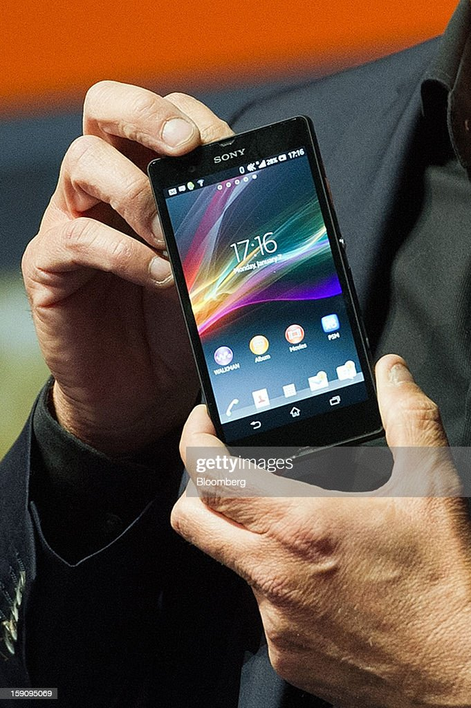 Phil Molyneux, president and chief operating officer of Sony Electronics Inc., holds up a Sony Xperia Z smart phone as he speaks during a news conference at the 2013 Consumer Electronic Show in Las Vegas, Nevada, U.S., on Monday, Jan. 7, 2013. The 2013 CES trade show, which runs until Jan. 11, is the world's largest annual innovation event that offers an array of entrepreneur focused exhibits, events and conference sessions for technology entrepreneurs. Photographer: David Paul Morris/Bloomberg via Getty Images