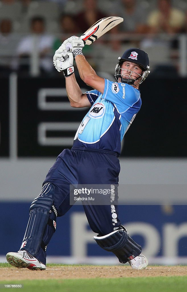 <a gi-track='captionPersonalityLinkClicked' href=/galleries/search?phrase=Phil+Mustard&family=editorial&specificpeople=824851 ng-click='$event.stopPropagation()'>Phil Mustard</a> of Auckland hits a six during the HRV Cup Twenty20 match between the Auckland Aces and Wellington Firebirds at Eden Park on December 28, 2012 in Auckland, New Zealand.