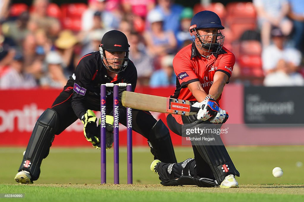 Phil Mustard of Durham plays a shot as Niall O'Brien of Leicestershire looks on during the Natwest T20 Blast match between Leicestershire Foxes and...