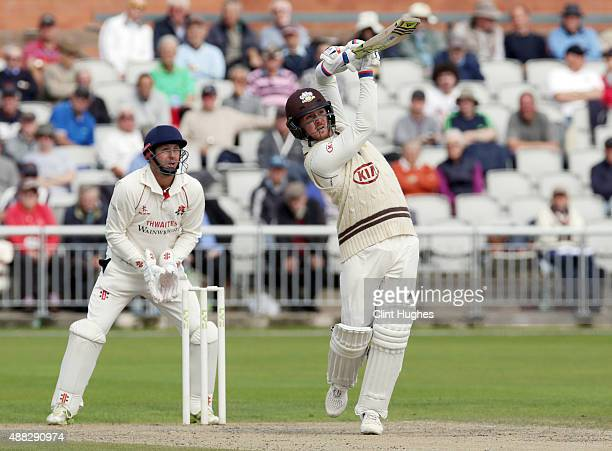 Phil Mustard of Lancashire looks on as Jason Roy of Surrey hits out during day two of the LV County Championship Division Two match between...