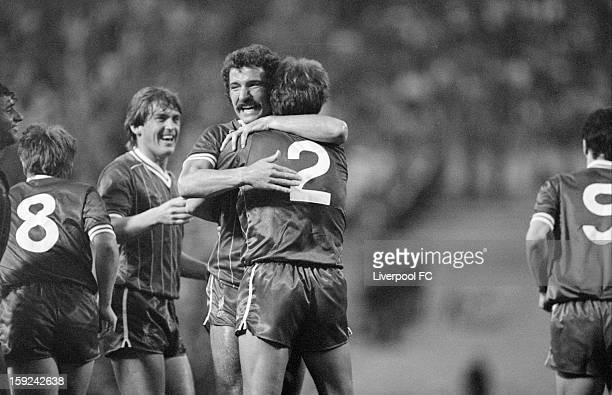 Phil Neal of Liverpool celebrates scoring the opening goal of the match with captain Graeme Souness during the UEFA European Cup Final between AS...