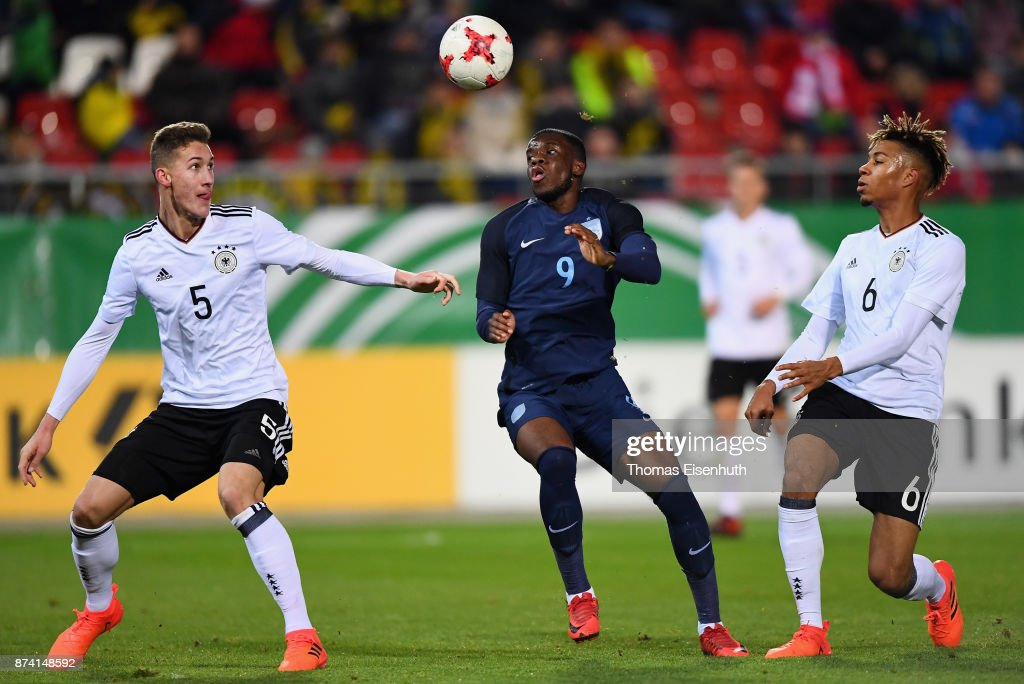 Phil Neumann (L) and Sidney Friede (R) of Germany and Stephy Mavididi of England vie for the ball during the Under 20 International Friendly match between U20 of Germany and U20 of England at Stadion Zwickau on November 14, 2017 in Zwickau, Germany.