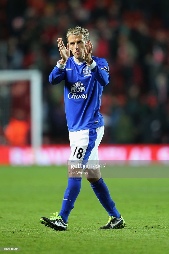 Phil Neville of Everton applauds the travelling fans after the Barclays Premier League match between Southampton and Everton at St Mary's Stadium on January 21, 2013 in Southampton, England.