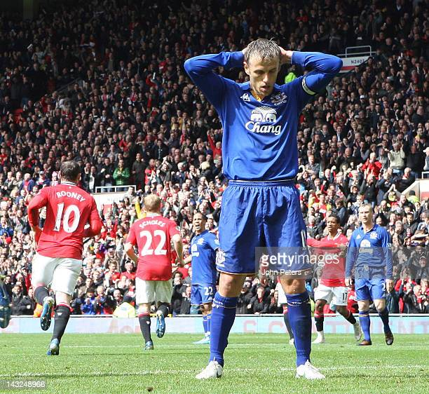 Phil Neville of Everton reacts to conceding Wayne Rooney's goal during the Barclays Premier League match between Manchester United and Everton at Old...