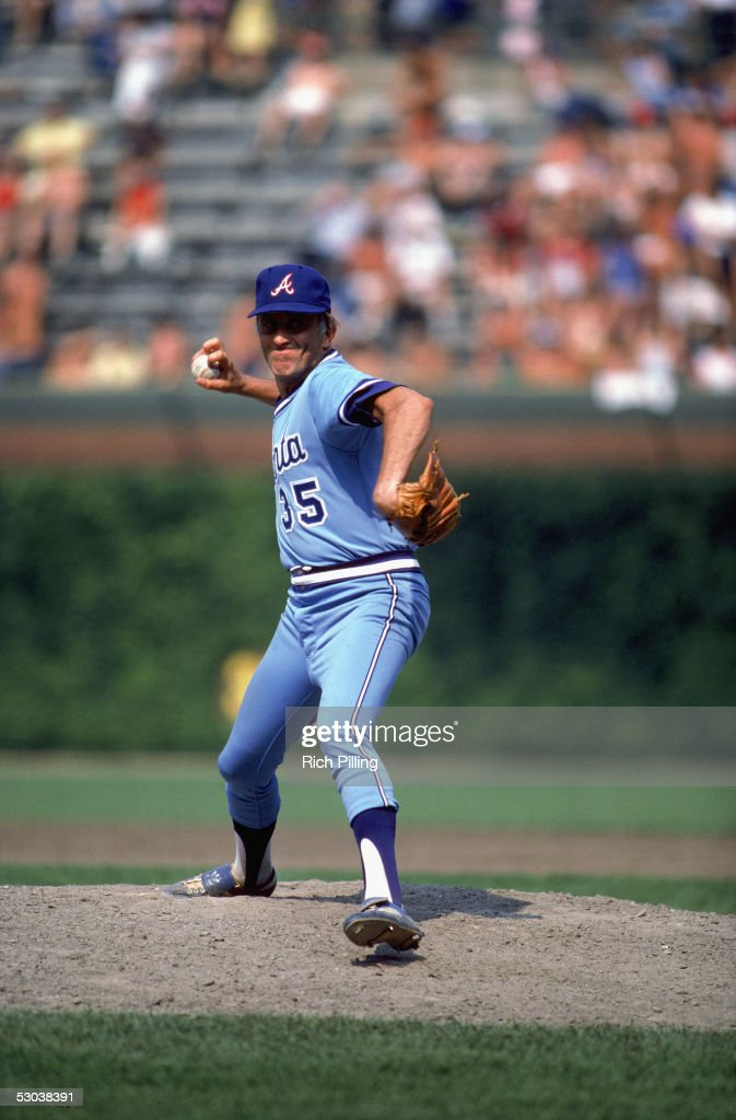 Phil Niekro of the Atlanta Braves winds back for the pitch during a game Phil Niekro played for the Atlanta Braves from 19641983 and returned in 1987