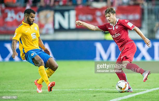 Phil OfosuAyeh challenges Daniel Halfar during the 2 Bundesliga match between 1 FC Kaiserslautern and Eintracht Braunschweig at FritzWalterStadion on...