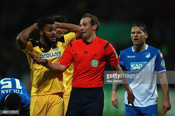 Phil OfosuAyeh of Aalen discusses with referee Sascha Stegemann during the DFB Cup Round of 16 match between VfR Aalen and 1899 Hoffenheim at Scholz...