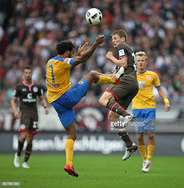 Phil OfosuAyeh of Braunschweig and Daniel Buballa of Pauli battle for the ball during the Second Bandesliga match between FC St Pauli and Eintracht...