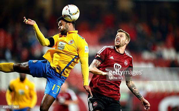 Phil OfosuAyeh of Braunschweig and Guido Burgstaller of Nuernberg tussle for the ball during the Second Bundesliga match between 1 FC Nuernberg and...