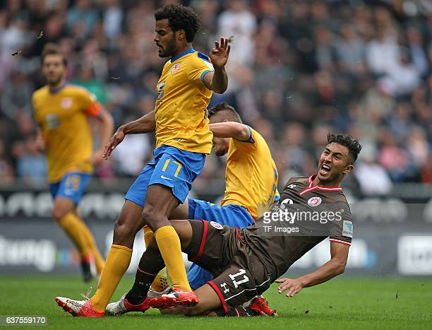 Phil OfosuAyeh of Braunschweig and Gustav Valsvik of Braunschweig and Aziz Bouhaddouz of Pauli battle for the ball during the Second Bandesliga match...