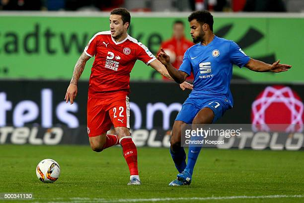 Phil OfosuAyeh of Braunschweig challenges Sercan Sararer of Duesseldorf during the Second Bundesliga match between Fortuna Duesseldorf and Eintracht...