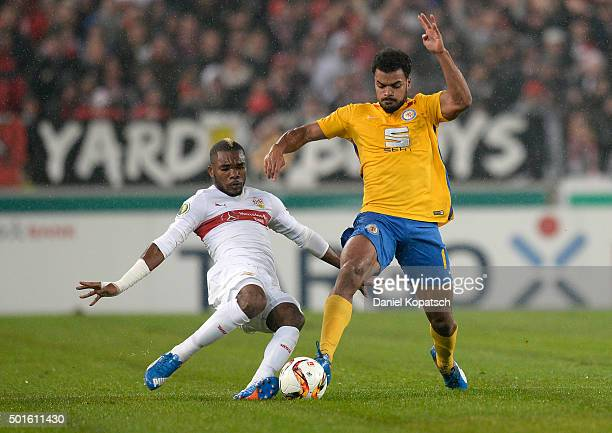 Phil OfosuAyeh of Braunschweig is challenged by Serey Die of Stuttgartduring the round of sixteen DFB Cup match between VfB Stuttgart and Eintracht...