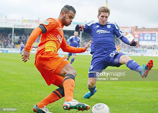 Phil OfosuAyeh of Duisburg competes for the ball with Michael Hohnstedt of Osnabrueck during the Third League match between between VfL Osnabrueck...