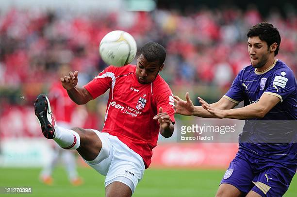 Phil OfosuAyeh of Rot Weiss Erfurt and Stephan Sager of VFL Osnabrueck battle for the ball during the Third League match between RotWeiss Erfurt and...