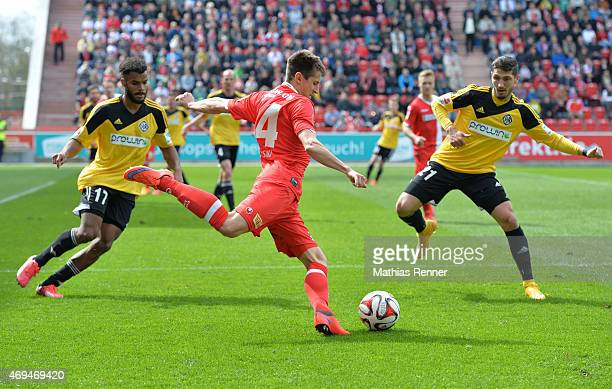 Phil OfosuAyeh Steven Skrzybski of 1 FC Union Berlin and Fabio Kaufmann of VfR Aalen during the game between Union Berlin and VfR Aalen on april 12...