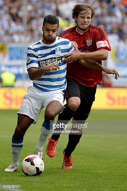 Phil OfosuAyeh vies with Benjamin Foerster of Chemnitz during the 3 Liga match between MSV Duisburg and Chemintzer FC at SchauinslandReisenArena on...
