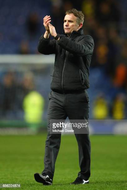 Phil Parkinson the manager of Bolton applauds the travelling support after his sides 42 victory during the Sky Bet League One match between Oxford...
