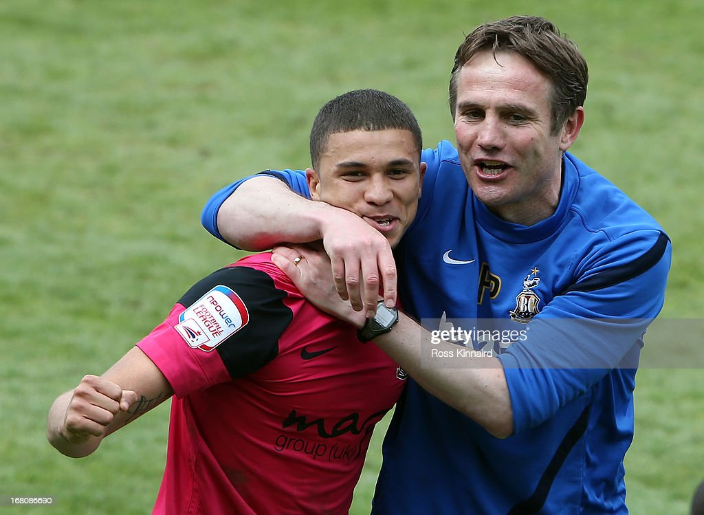 Phil Parkinson the manager of Bradford City and Nahki Well of Bradford celebrate after the npower League Two Play Off Semi Final: Second Leg match between Burton Albion and Bradford City at Pirelli Stadium on May 5, 2013 in Burton-upon-Trent, England.