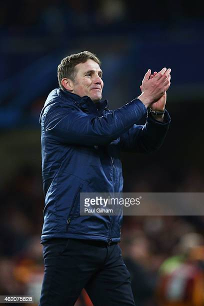 Phil Parkinson the manager of Bradford City applauds the travelling fans following his team's 42 victory during the FA Cup Fourth Round match between...