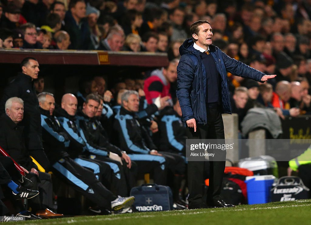Phil Parkinson the manager of Bradford City gives instructions to his players during the Capital One Cup Semi-Final 1st Leg match between Bradford City and Aston Villa at Coral Windows Stadium, Valley Parade on January 8, 2013 in Bradford, England.