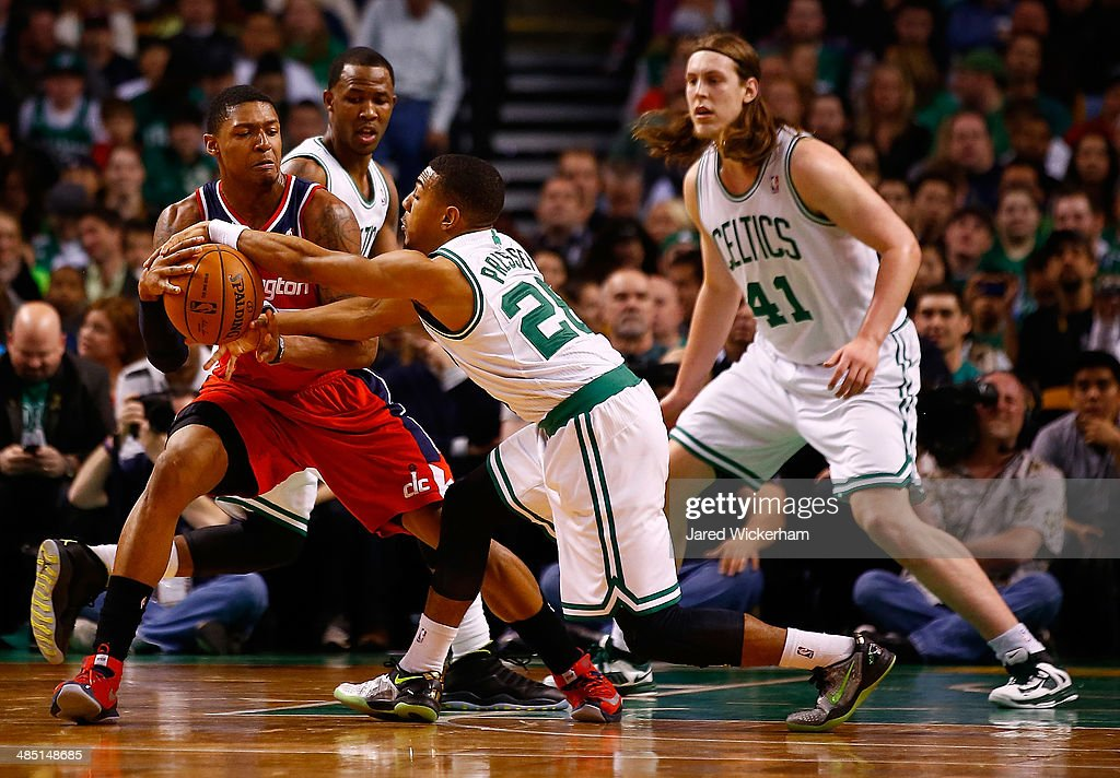 Phil Pressey #26 of the Boston Celtics attempts to steal the ball from Bradley Beal #3 of the Washington Wizards in the second quarter during the game at TD Garden on April 16, 2014 in Boston, Massachusetts.