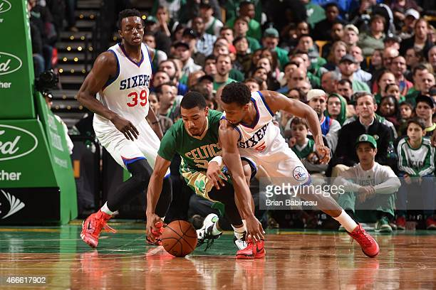 Phil Pressey of the Boston Celtics battles for the loose ball against Ish Smith of the Philadelphia 76ers on March 16 2015 at the TD Garden in Boston...