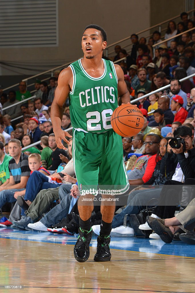 <a gi-track='captionPersonalityLinkClicked' href=/galleries/search?phrase=Phil+Pressey&family=editorial&specificpeople=7399881 ng-click='$event.stopPropagation()'>Phil Pressey</a> #26 of the Boston Celtics brings the ball up court against the Philadelphia 76ers at the Bob Carpenter Center on October 11, 2013 in Newark, Delaware.