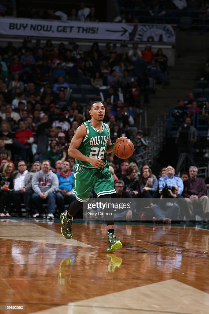 Phil Pressey of the Boston Celtics brings the ball up court against the Milwaukee Bucks on April 15 2015 at the BMO Harris Bradley Center in...