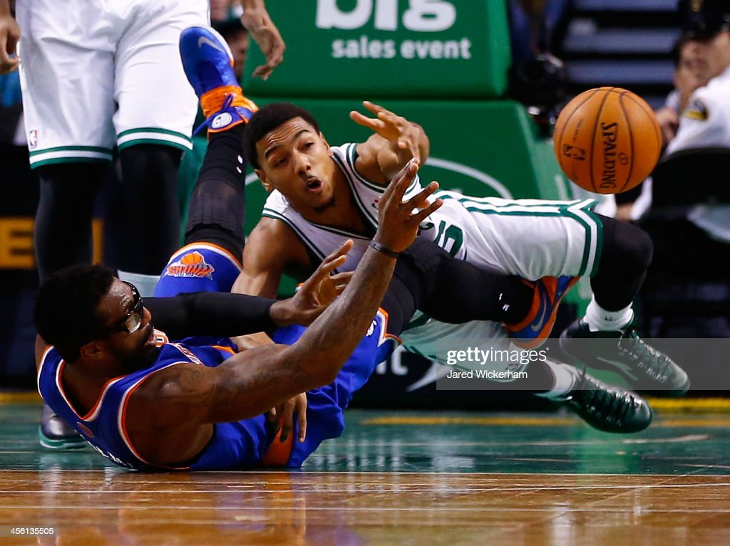 Phil Pressey of the Boston Celtics dives for a loose ball in front of Amar'e Stoudemire of the New York Knicks in the second half during the game at...