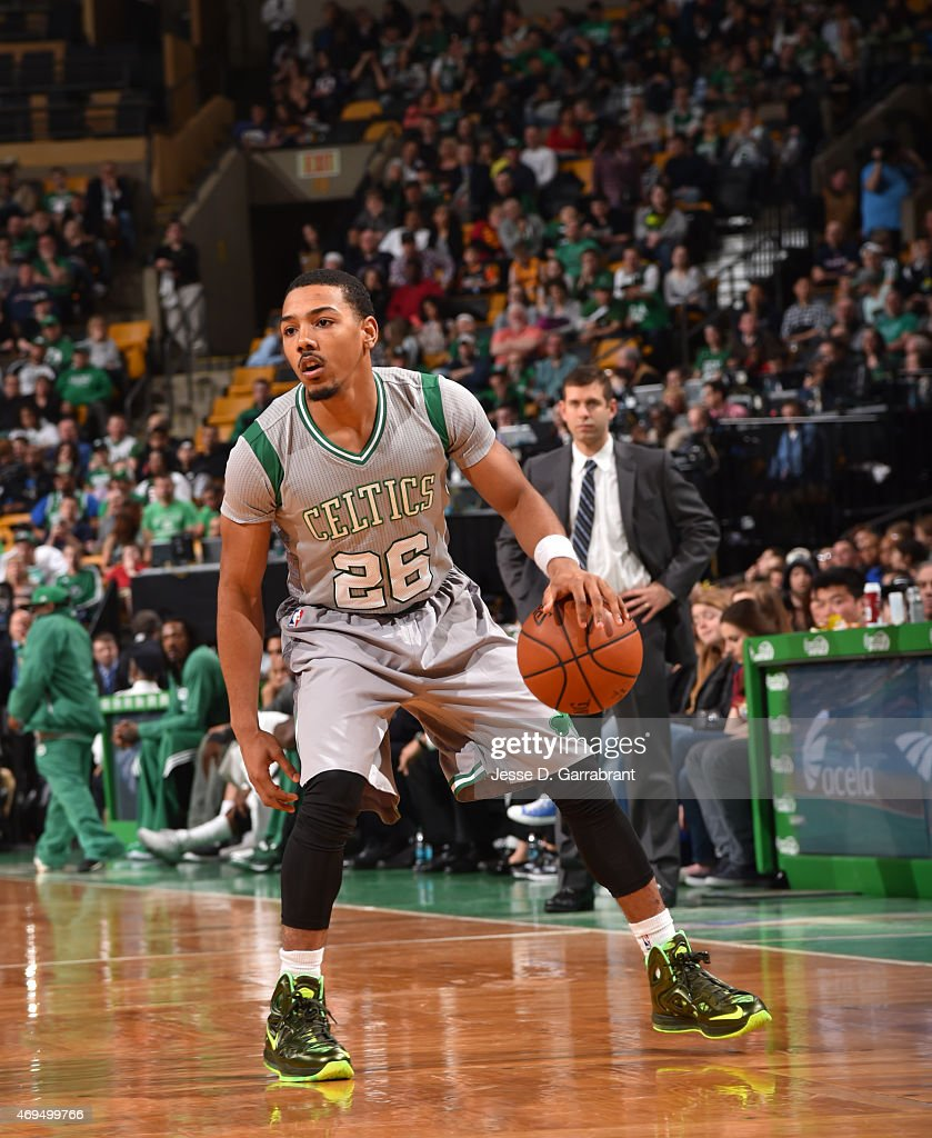 Phil Pressey of the Boston Celtics dribbles the ball against the Cleveland Cavilers at the TD Garden on April 12 2015 in Boston MassachusettsNOTE TO...