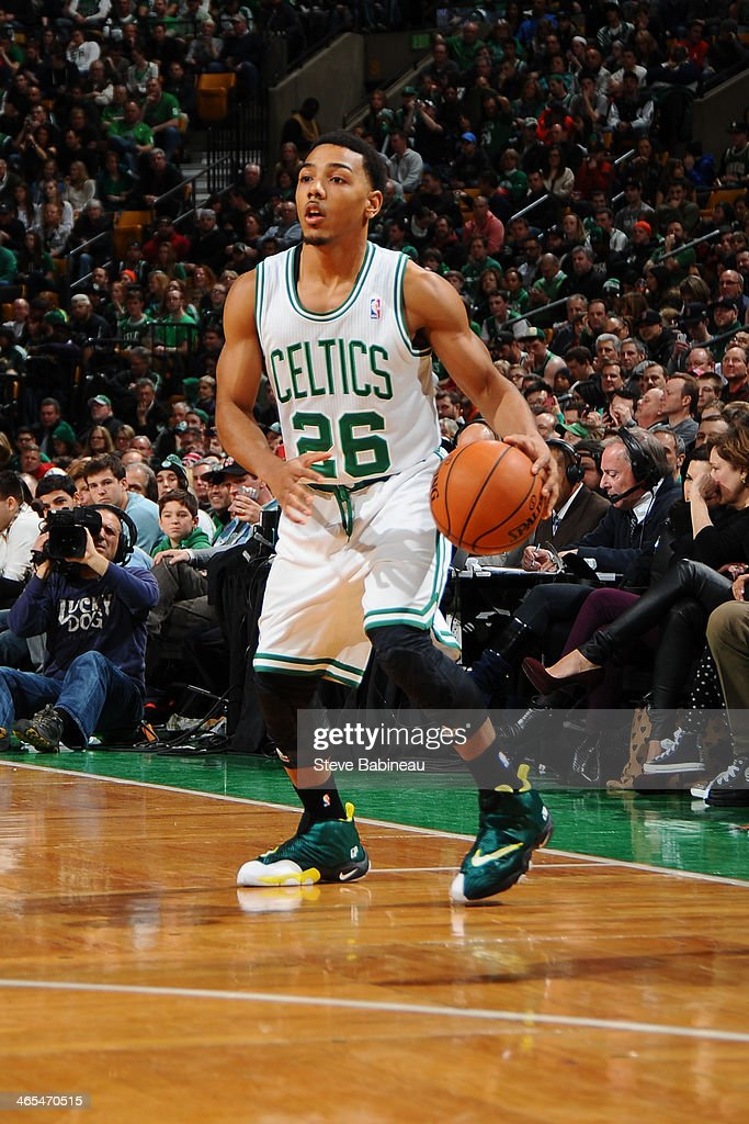 Phil Pressey of the Boston Celtics dribbles the ball against the Brooklyn Nets on January 26 2014 at the TD Garden in Boston Massachusetts NOTE TO...