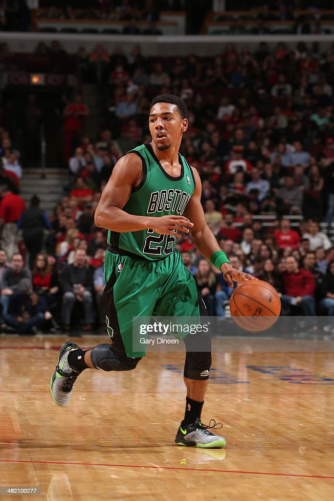 Phil Pressey #26 of the Boston Celtics dribbles the ball during the game against the Chicago Bulls on March 31, 2014 at the United Center in Chicago, Illinois.