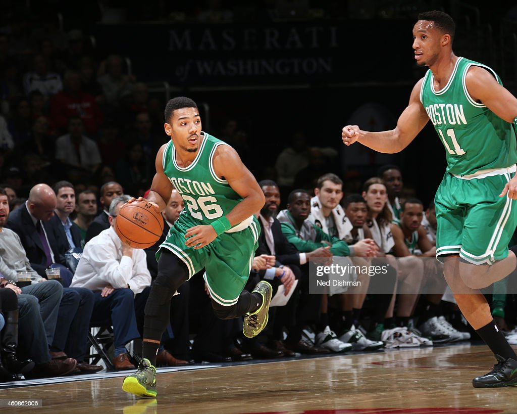 Phil Pressey of the Boston Celtics drives down the court against the Washington Wizards during the game on December 27 2014 at Verizon Center in...