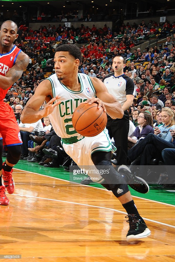 Phil Pressey of the Boston Celtics drives the ball against the Philadelphia 76ers on January 29 2014 at the TD Garden in Boston Massachusetts NOTE TO...