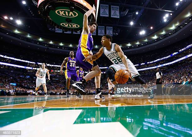 Phil Pressey of the Boston Celtics drives the baseline past Ryan Kelly of the Los Angeles Lakers in the second quarter during the game at TD Garden...