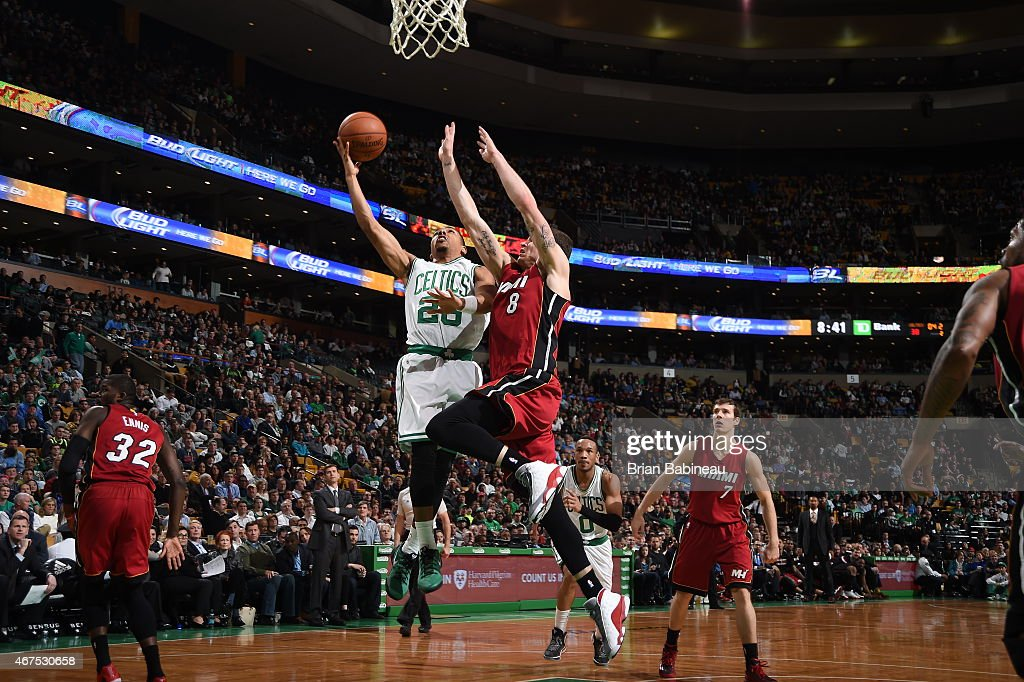 Phil Pressey of the Boston Celtics goes to the basket against Tyler Johnson of the Miami Heat on March 25 2015 at TD Garden in Boston Massachusetts...