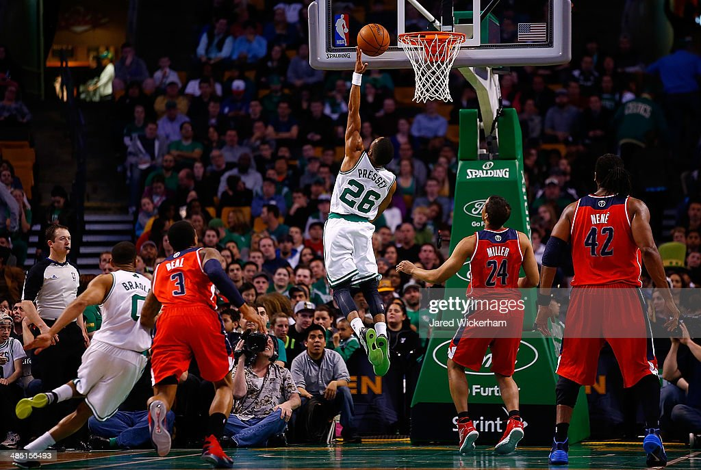 Phil Pressey #26 of the Boston Celtics goes up for a layup against the Washington Wizards in the second half during the game at TD Garden on April 16, 2014 in Boston, Massachusetts.