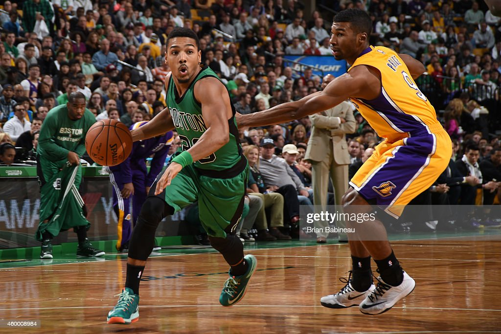 Phil Pressey of the Boston Celtics handles the ball against the Los Angeles Lakers on December 5 2014 at the TD Garden in Boston Massachusetts NOTE...