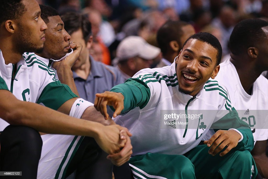 Phil Pressey of the Boston Celtics laughs on the bench during the fourth quarter against the Milwaukee Bucks at TD Garden on April 3 2015 in Boston...