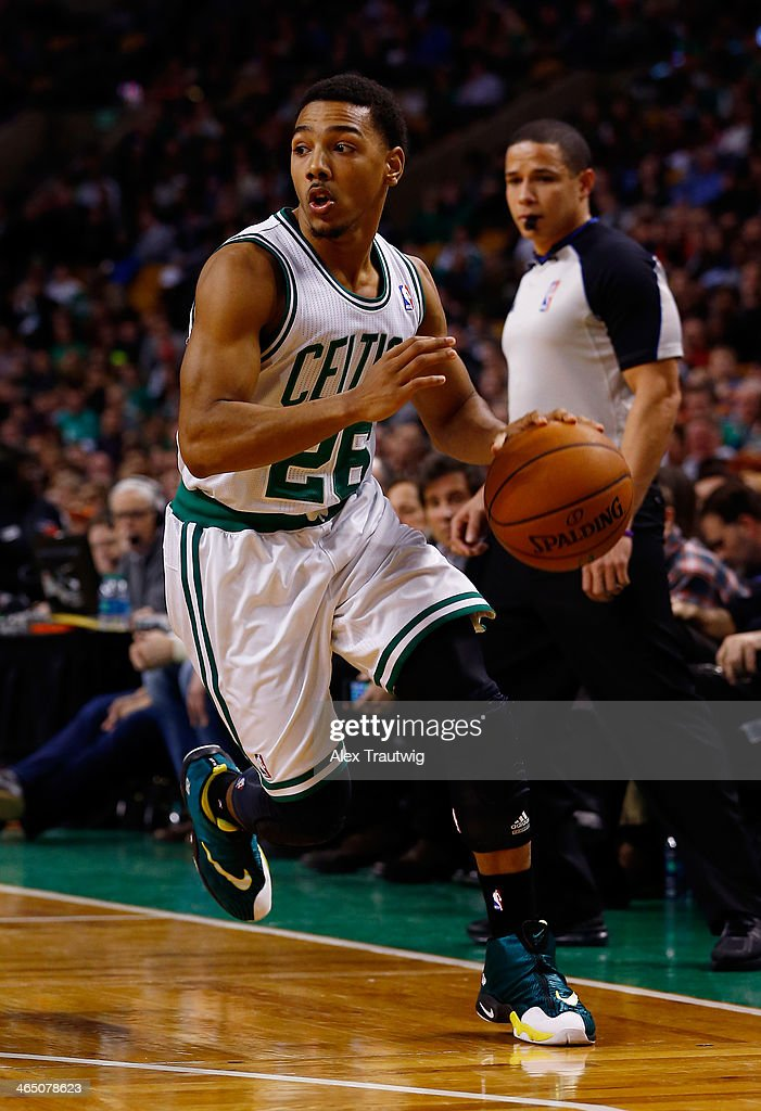 Phil Pressey of the Boston Celtics looks to pass against the Oklahoma City Thunder during a game at the TD Garden on January 24 2014 in Boston...