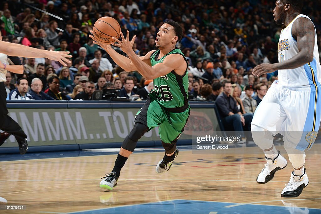 <a gi-track='captionPersonalityLinkClicked' href=/galleries/search?phrase=Phil+Pressey&family=editorial&specificpeople=7399881 ng-click='$event.stopPropagation()'>Phil Pressey</a> #26 of the Boston Celtics makes a pass against the Denver Nuggets on January 7, 2014 at the Pepsi Center in Denver, Colorado.