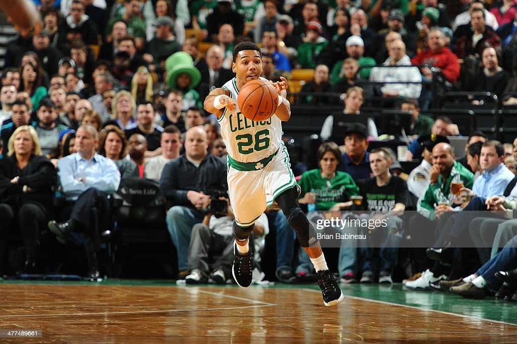 Phil Pressey of the Boston Celtics passes the ball against the Golden State Warriors on March 5 2014 at the TD Garden in Boston Massachusetts NOTE TO...