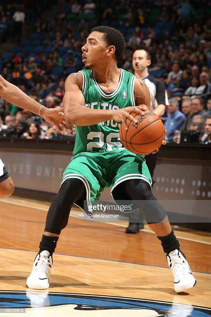 Phil Pressey #26 of the Boston Celtics passes the ball against the Minnesota Timberwolves on November 16, 2013 at Target Center in Minneapolis, Minnesota.