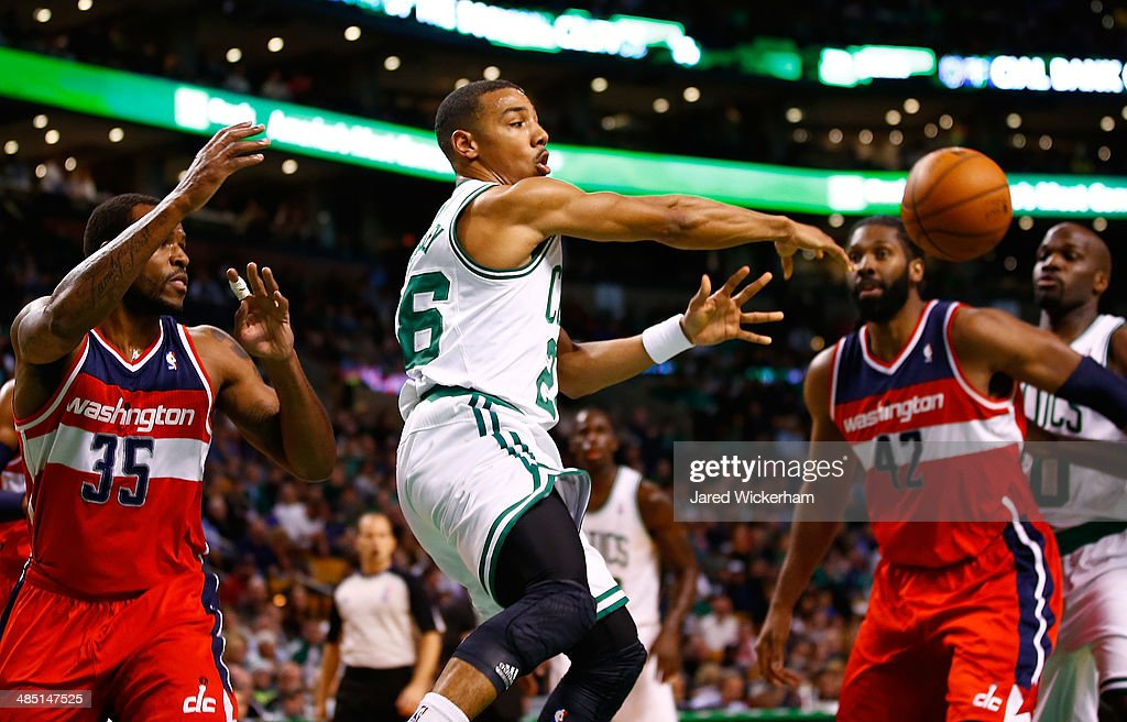 Phil Pressey #26 of the Boston Celtics passes the ball in front of Trevor Booker #35 of the Washington Wizards in the first quarter during the game at TD Garden on April 16, 2014 in Boston, Massachusetts.