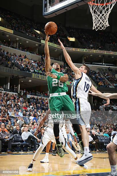 Phil Pressey of the Boston Celtics shoots against Beno Udrih of the Memphis Grizzlies during the game on November 21 2014 at FedExForum in...