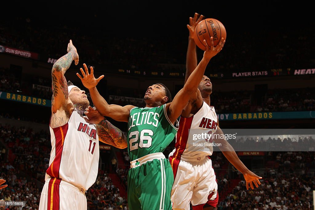 Phil Pressey #26 of the Boston Celtics shoots against Chris Andersen #11 of the Miami Heat on November 9, 2013 at American Airlines Arena in Miami, Florida.