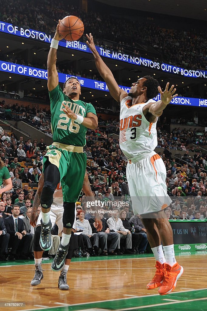 Phil Pressey of the Boston Celtics shoots against Ish Smith of the Phoenix Suns on March 14 2014 at the TD Garden in Boston Massachusetts NOTE TO...
