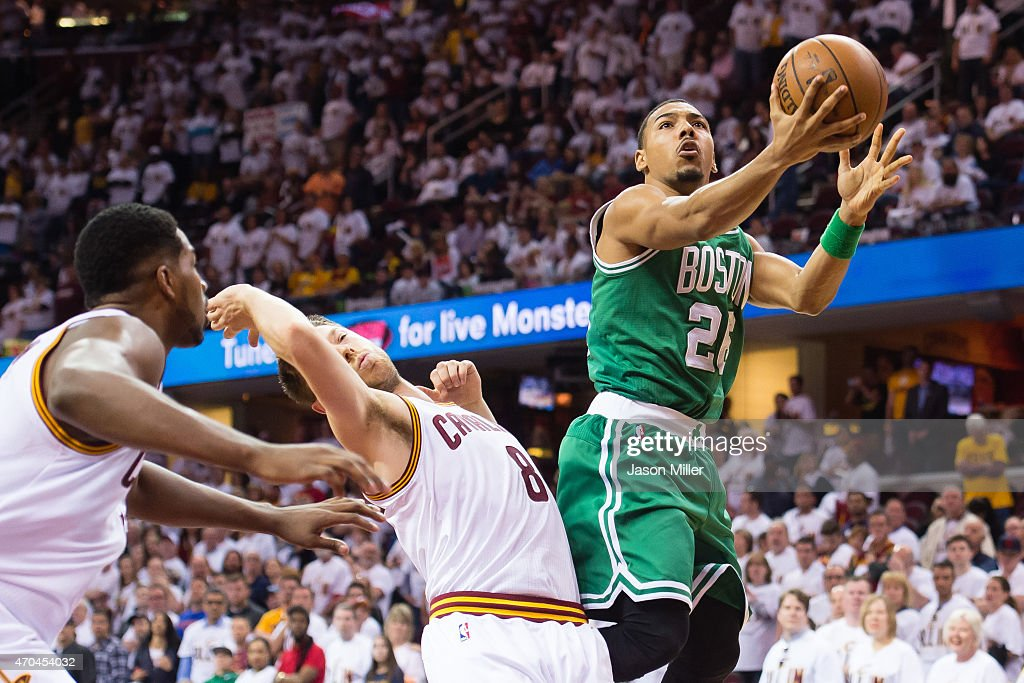 Phil Pressey of the Boston Celtics shoots over Matthew Dellavedova of the Cleveland Cavaliers in the second half during Game One in the Eastern...